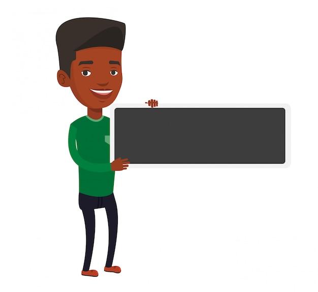 Junger afroamerikanermann, der leeres brett hält.