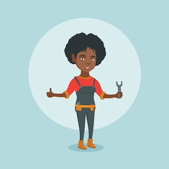Junger afroamerikanerschlosser, der einen schlüssel hält