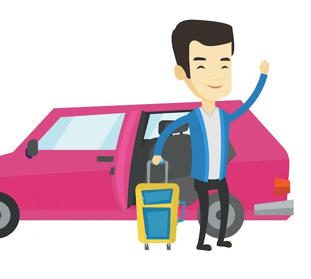 Junger asiatischer mann, der mit dem auto reist.