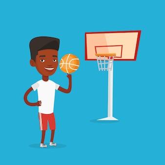 Junger basketballspieler, der ball dreht.