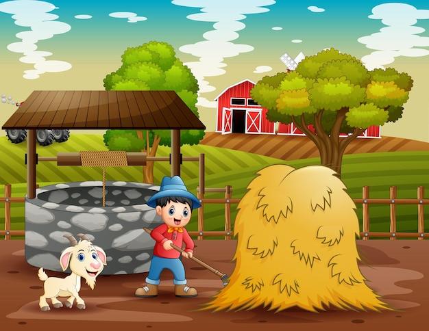 Junger bauer, der in der farmlandschaft arbeitet