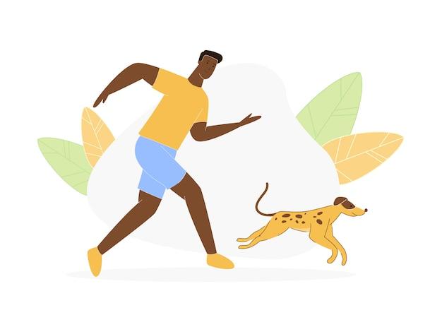 Junger dunkelhäutiger mann, der mit verspieltem hund geht