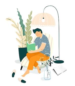 Junger erwachsener mann oder teenager, der ein buch auf dem sofa liest. home interior design, studieren und entspannen zu hause lesen buchkonzept.