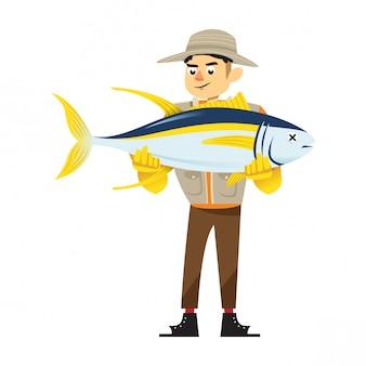 Junger fischer, der einen thunfisch trägt