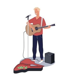 Junger glücklicher männlicher gitarrist, der steht und busking, indem er gitarre auf der stadtstraße spielt.