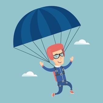 Junger glücklicher mann mit einem fallschirm fliegen.
