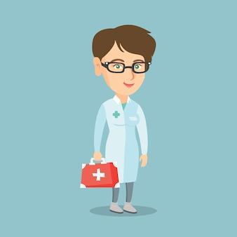 Junger kaukasischer doktor, der einen kasten der ersten hilfe anhält.