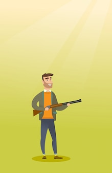 Junger kaukasischer jäger, der ein jagdgewehr hält