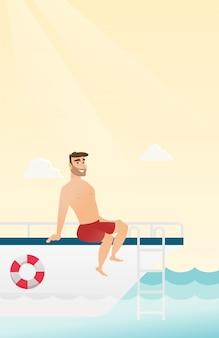 Junger kaukasischer mann, der auf der yacht sich bräunt.