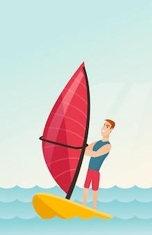 Junger kaukasischer mann, der in das meer windsurft