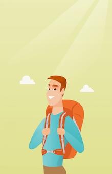 Junger kaukasischer reisendmann mit einem rucksack
