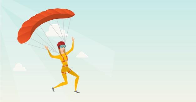 Junger kaukasischer skydiver, der mit einem fallschirm fliegt