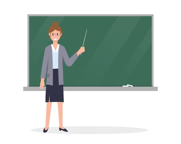 Junger lehrer mit einem zeiger nahe der tafel im klassenzimmer.