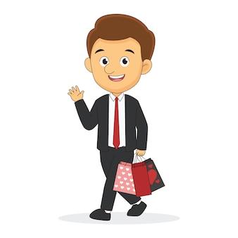 Junger mann, der anzug trägt und einkaufstaschen hält, valentinstag