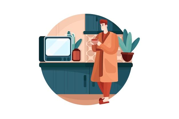 Junger mann, der den ofen in der küche betrachtet