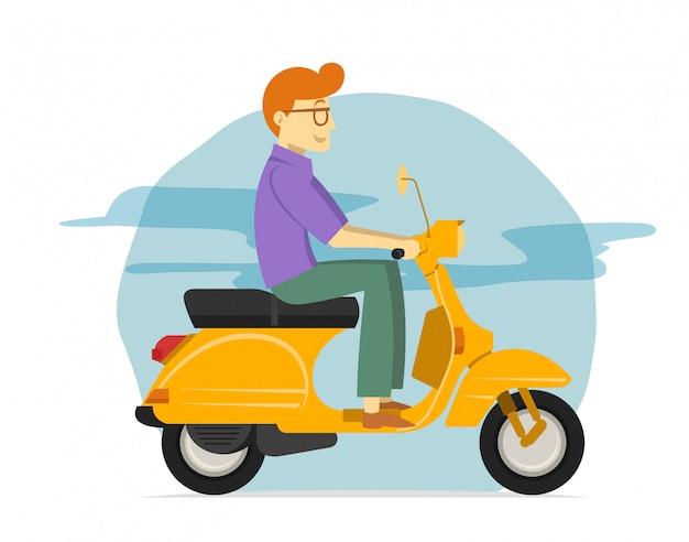Junger mann, der gelbes rollermotorrad reitet