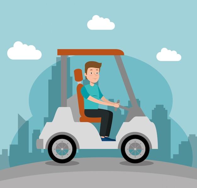Junger mann, der golfmobil fährt