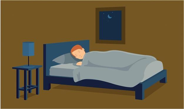 Junger mann, der im bett seiner wohnung schläft