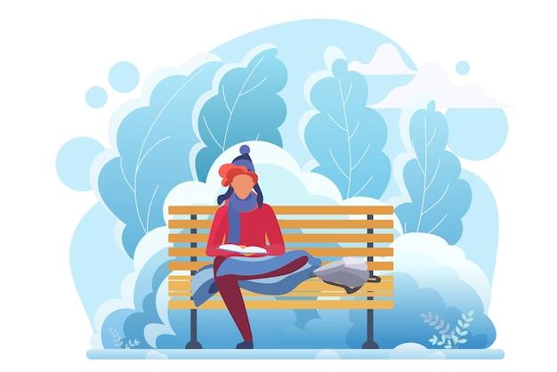 Junger mann, der in der kalten winterparkwohnung liest. kluges studentenstudium, bücherwurm-zeichentrickfigur. junge sitzt auf bank mit buch. literaturhobby, intellektuelle erholung