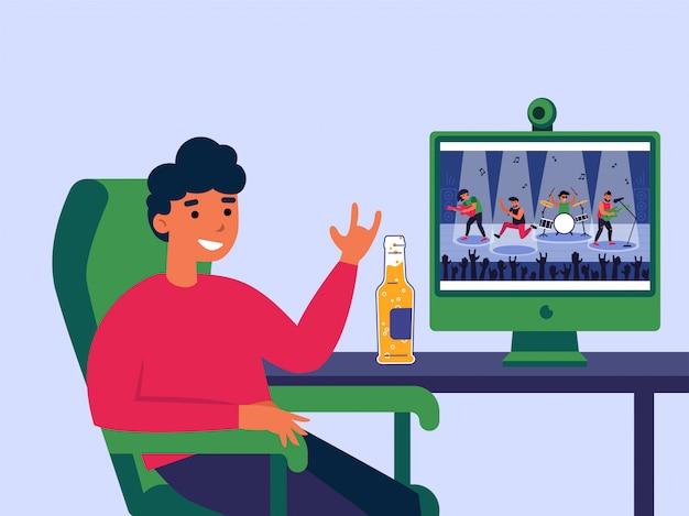 Junger mann, der konzert online am computer sieht