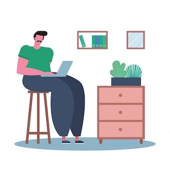 Junger mann, der laptop benutzt und im haus arbeitet