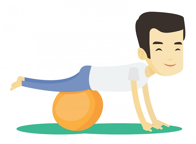 Junger mann, der mit fitball trainiert.