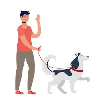 Junger mann, der mit hund geht, der aktivität übt.