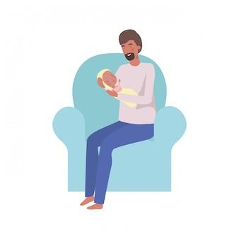 Junger mann, der mit neugeborenem baby in den armen sitzt