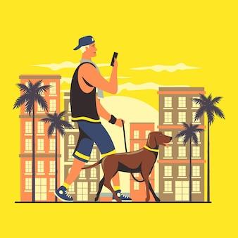 Junger mann, der mit seinem hund spazieren geht