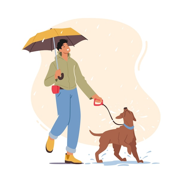 Junger mann, der mit verspieltem hund bei regnerischem wetter geht