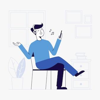 Junger mann, der musik im wohnzimmer hört.