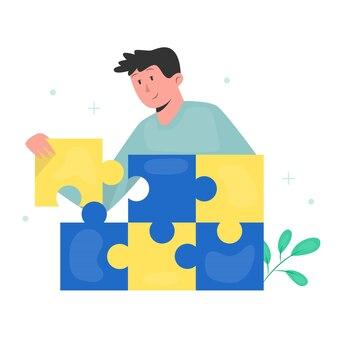 Junger mann, der puzzle setzt
