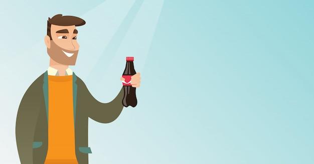 Junger mann, der soda trinkt