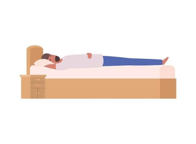 Junger mann im bett mit schlafenhaltung
