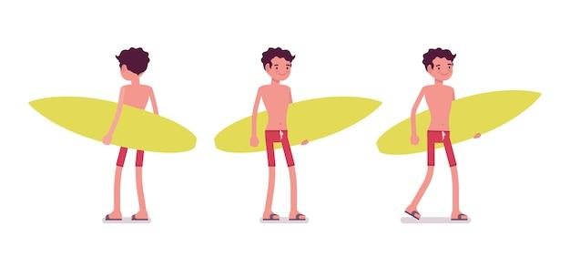 Junger mann in der sommerstrandausstattung mit surfbrett