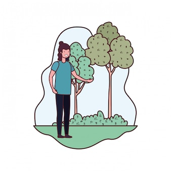 Junger mann in landschaft mit bäumen und pflanzen