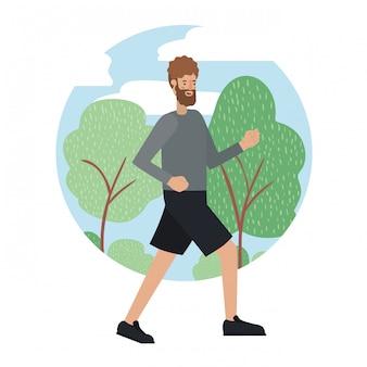 Junger mann mit bart im park laufen