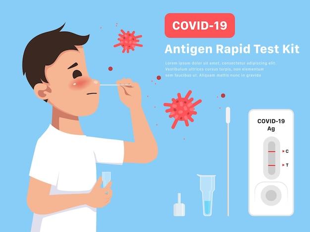 Junger mann mit covid19-antigen-testkit selbstverabreichter abstrich
