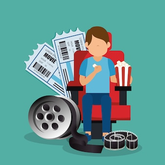 Junger mann mit kinematografischen symbolen