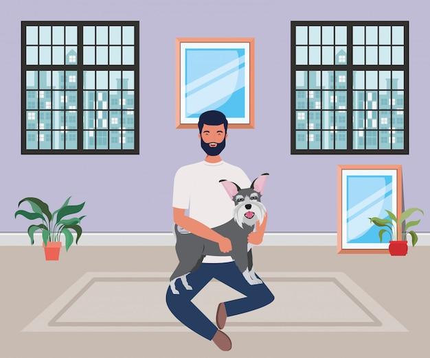 Junger mann mit nettem hundemaskottchen im raumhaus