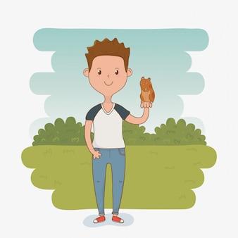 Junger mann mit nettem meerschweinchenmaskottchen