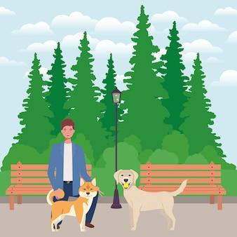 Junger mann mit netten hundemaskottchen im park