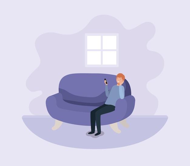 Junger mann mit smartphone am sofa