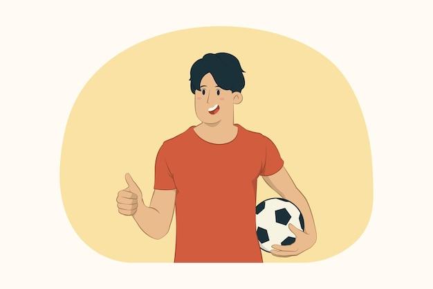 Junger mann muntert unterstützungsfavoritenteam mit fußball auf, der daumen oben zeigt