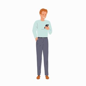 Junger mann schaut isoliert in das smartphone