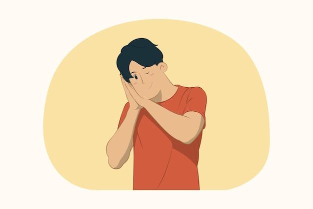 Junger mann schlafen mit gefalteten händen unter wangenkonzept
