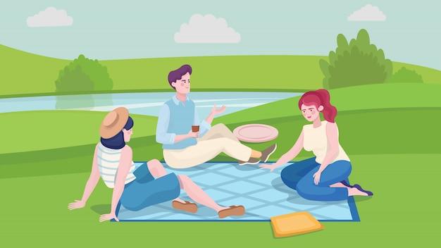 Junger mann und zwei mädchen beim sommerpicknick