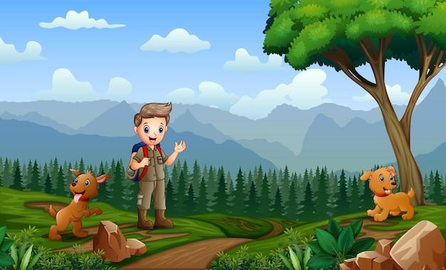 Junger pfadfinder mit seinem haustier an der natur