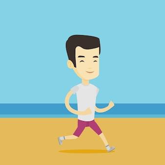 Junger sportlicher mann, der am strand joggt.