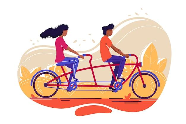Junger student, der fahrrad fährt